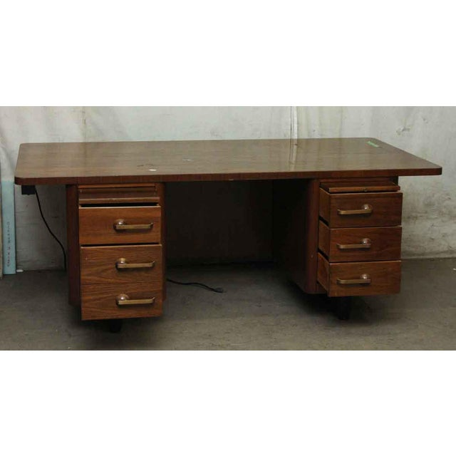 Interesting 1940s wooden desk with a walnut veneer and cool brass handles. It is in overall good condition, with some...