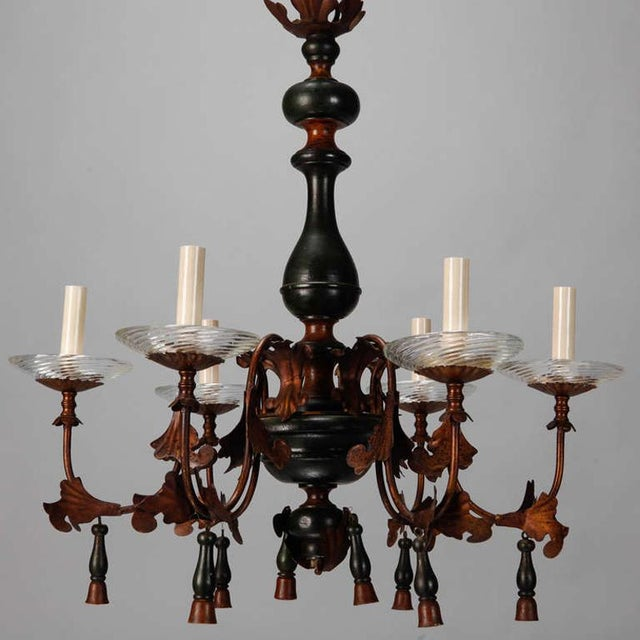 Circa 1920s Italian wood and gilt metal 6 arm chandelier with wood tassels and ribbed glass bobeches. Six lights, ribbed...