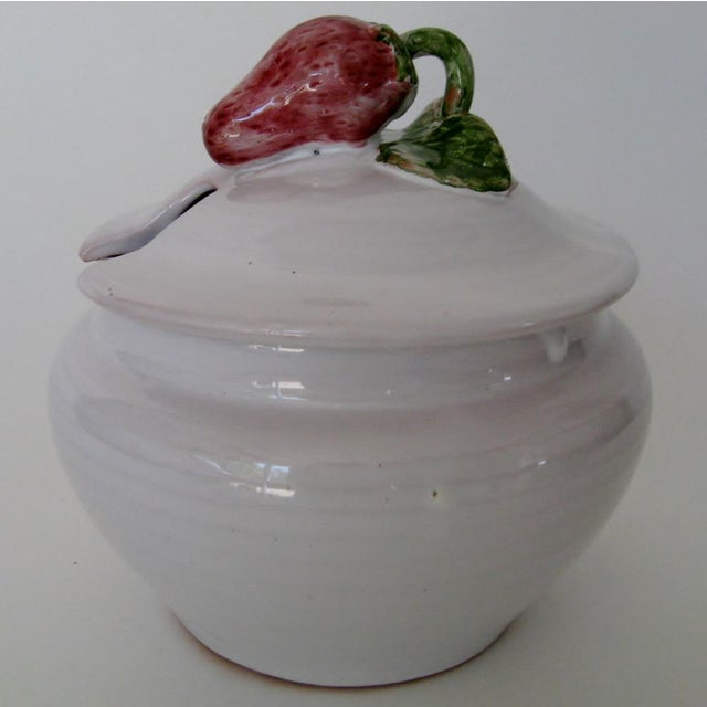 1950s Au Vieux Vallauris French Provençal lidded jam jar with strawberry accent. The jar was created in red clay with...