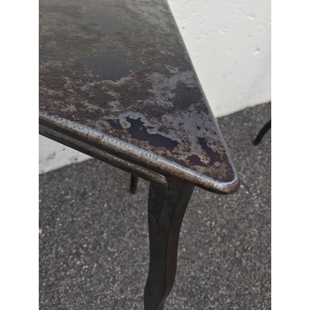 A pair of hand-forged steel modernist drink tables by NYC artist Will Stone. Triangular tops on wavy legs displaying...