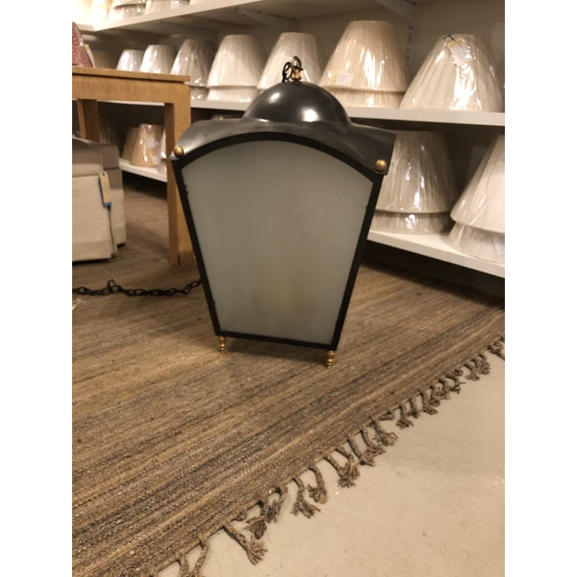 Make a statement with this hanging lantern, finished with a beautiful painted iron and gilt bronze and fitting for a wide...