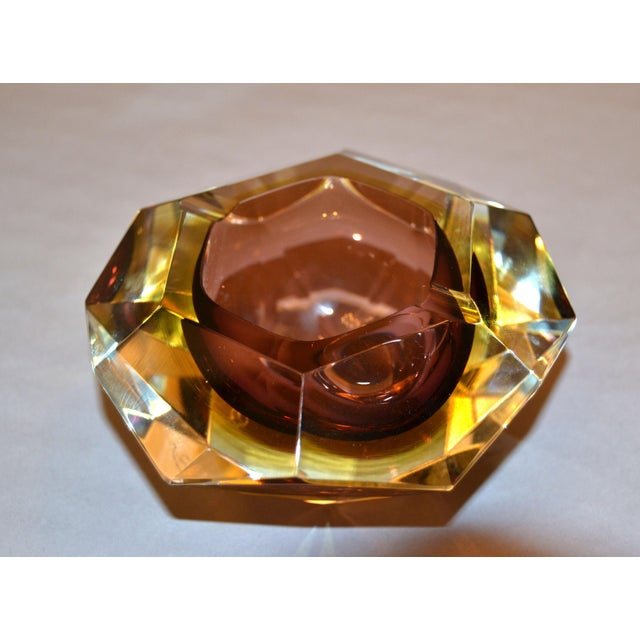 Multi faceted brown and yellow Sommerso Murano glass ashtray, glass bowl attributed to Flavio Poli. Brown and amber glass...