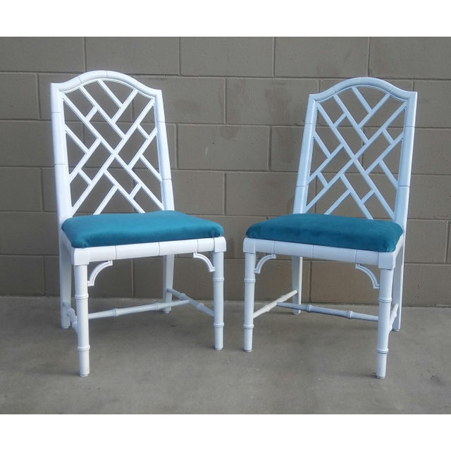 Fabulous pair of Hollywood Regency side chairs. Chinese Chippendale style with a gorgeous faux bamboo design. Reworked in...