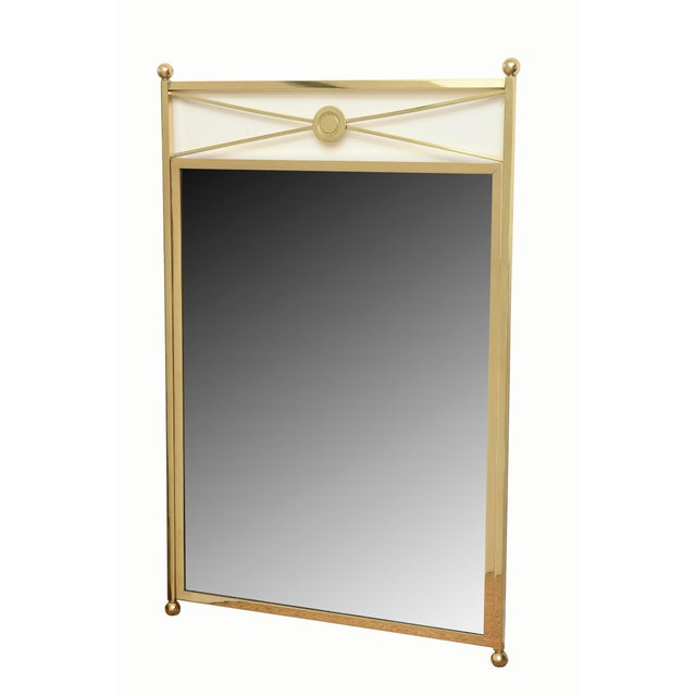 This very modernist designed mirror with a French Billy Haines influence has elegance and simplicity with it's ball...