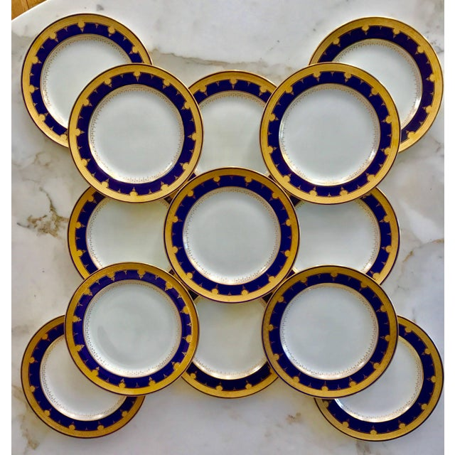 This Set of 12 beautiful cobalt blue and gold bordered Dinner Plates were produced by Minton and retailed by David...