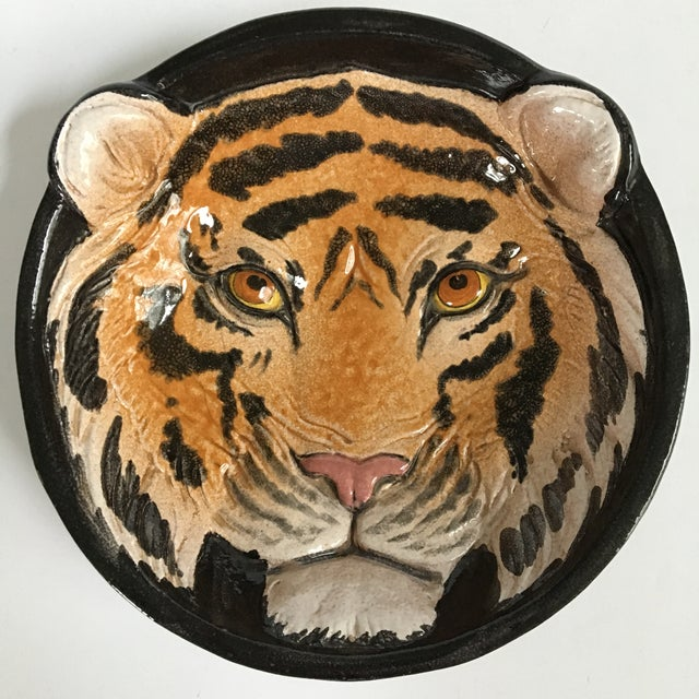 Offering an Italian glazed pottery Tiger face bowl/catchall/dish, in relief, that is hand painted and hand made. It is a...