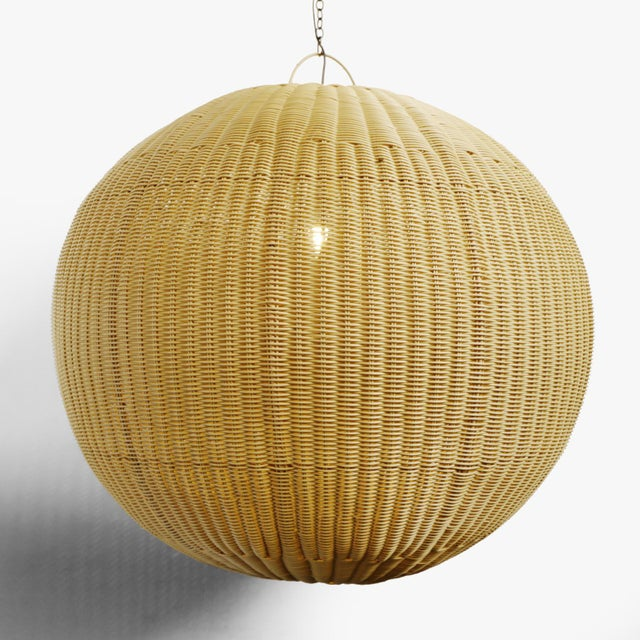 Outdoor faux rattan XL globe lantern. Beautifully woven synthetic rattan with a natural wicker appearance. Perfect for...