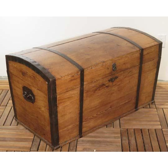 Antique English (c. 1890) pine dome top box with original metal strapping and hardware in a hand rubbed waxed finish.
