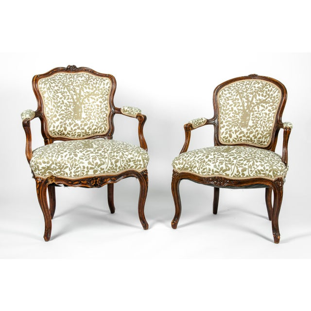 French pair of side / armchairs with hand-carved decorations attributed to Louis XVI style. Each side / armchair is in...