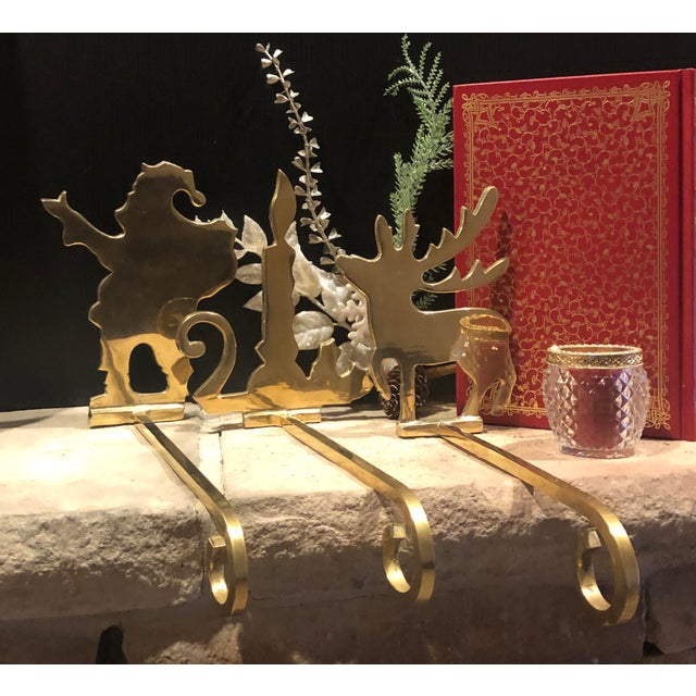 This is for 3 long arm solid Brass Stocking Hooks for the Holidays. This set includes one of each: Santa Claus with his...