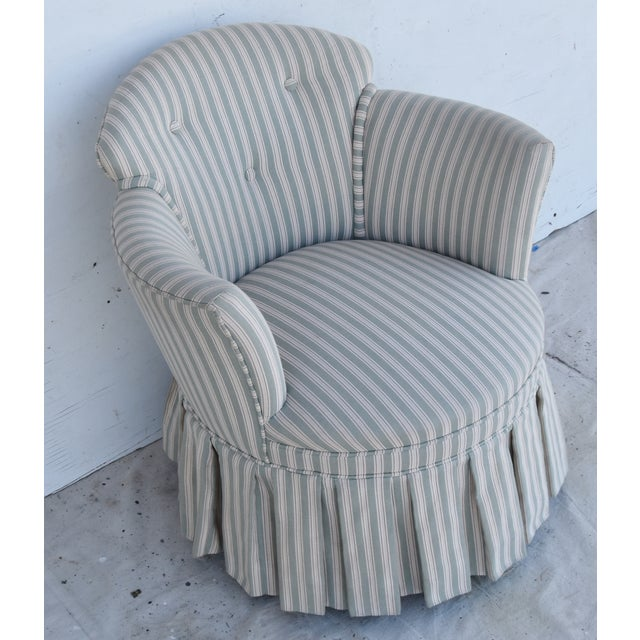 Vintage vanity chair with curved back and pleated skirt. Recently custom upholstered in a striped cotton fabric from...