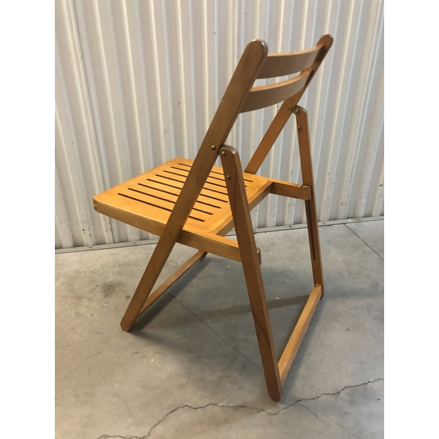 This is an awesome folding wood chair made in Romania. Works perfectly.