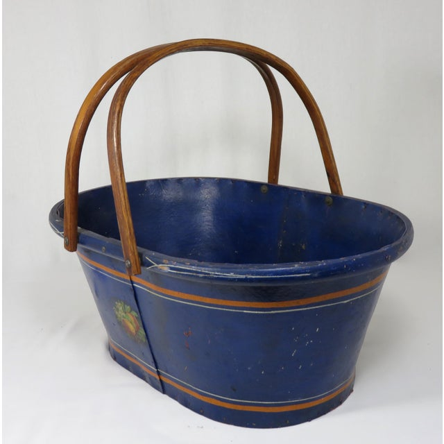 An American Antique - Victorian Grocery Shopping Carry Basket with Steam Bent Oak Swing Handles. It is made out of some...