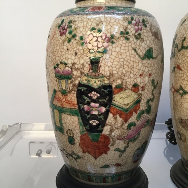 Beautiful antique Asian jars made into lamps . Delicately hand painted over craquelure glaze . Great vintage condition .