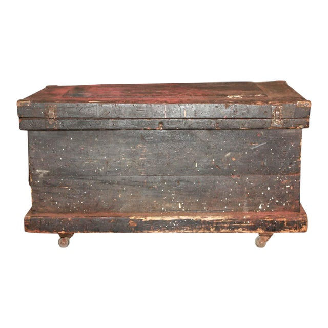 Antique 34.25 In. Distressed Wooden Black Trunk on Wheels For Sale