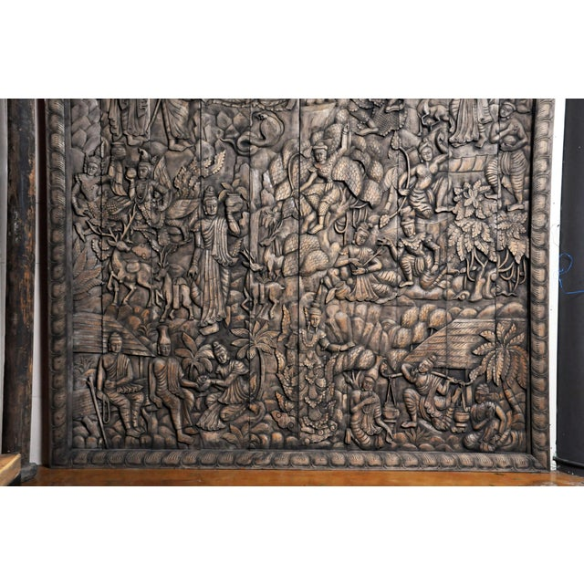 This newly hand-carved wall panel features a relief design representing the life and story of Buddha. It includes the Thai...