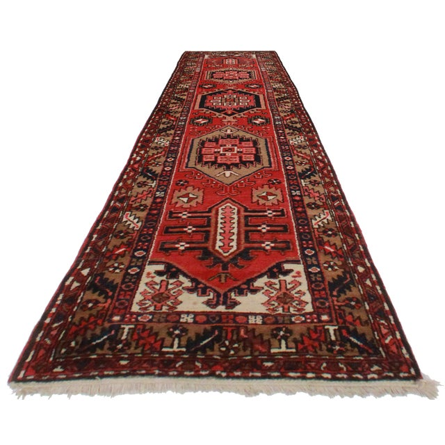 Offered here is this antique Persian Gharajeh runner rug. Made of hand-knotted wool. Lovely geometric design.