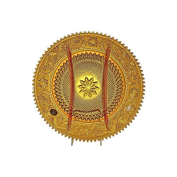 Large ornate vintage amber glass divided tray with an arabesque scroll and floral pattern on a stippled background and a...