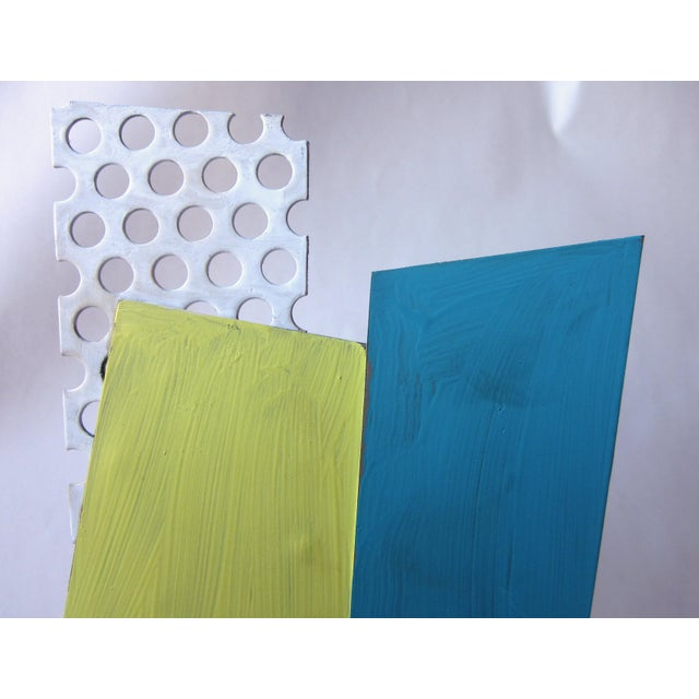 This is a vintage postmodern style pop art abstract geometric painted metal sculpture on a wooden base. It is painted...