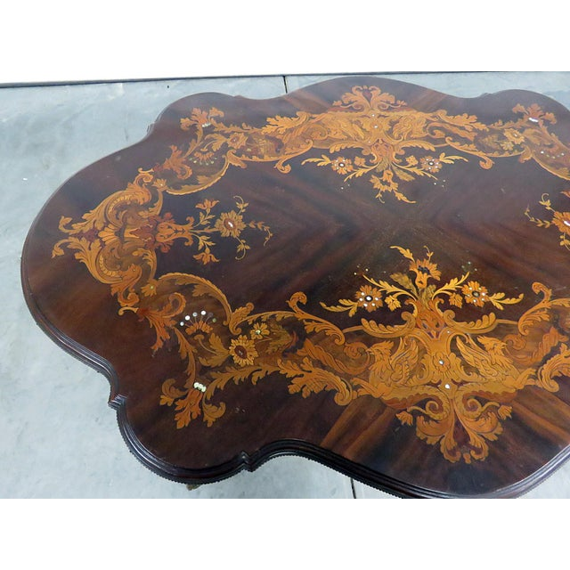 Early 20th Victorian bronze mounted inlaid center table.