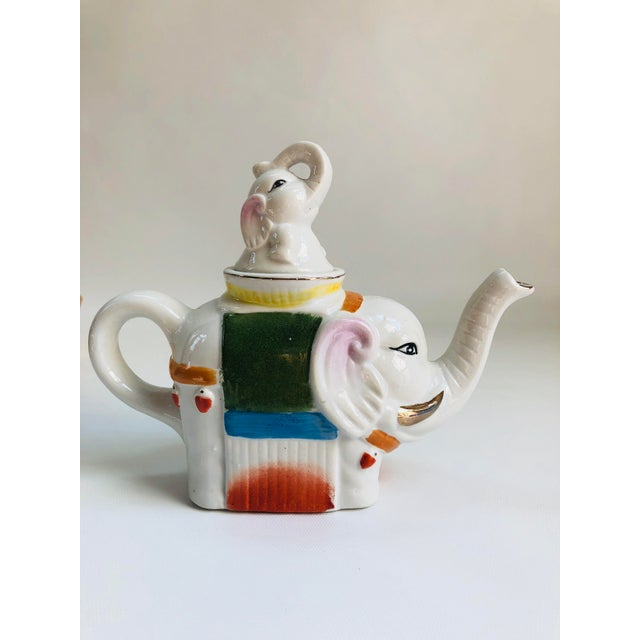 Whimsical Chinese porcelain teapot in the Famille Rose-style boldly decorated in vibrant colors. Unmarked. Circa 1970.