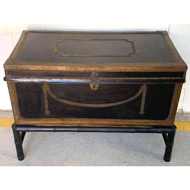 """English Regency brass studded leather chest on stand, in two parts, the leather trunk alone measures 16"""" H x 35.5"""" W x 18""""..."""