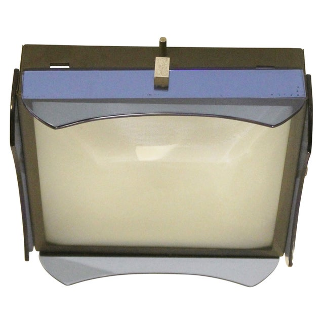 Simple yet elegant Veca flush mount designed with a square metal frame and a decorative blue glass on each side. The glass...