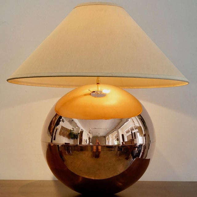 This is a Karl Springer copper orb table lamp. It consists of a two piece seamed & polished copper sphere. C. 1970's