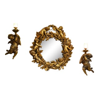 Antique Gold Figural Cherub Mirror With Cherub Wall Sconces - Set of 3 For Sale