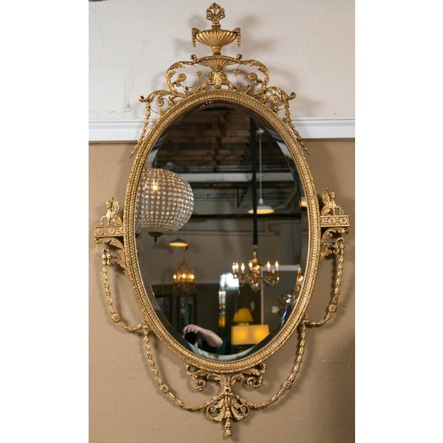 Pair of giltwood Adams style Friedman wall console mirrors. A fine pair of handcrafted mirrors by Friedman Brothers. Each...