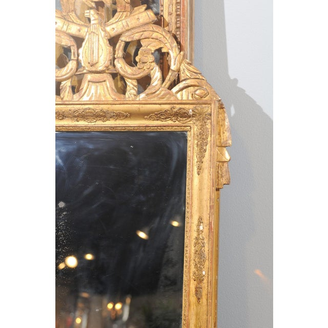 French Louis XV Style Giltwood Mirror with Hand Carved Liberal Arts Symbols For Sale - Image 9 of 10
