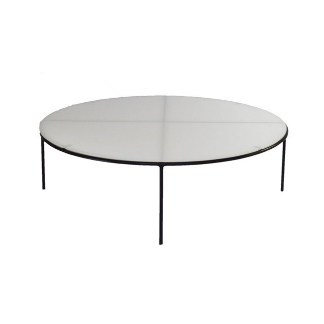 Large round milk glass top and iron base coffee table designed by T.H. Robsjohn-Gibbings. Offered by Neal Beckstedt