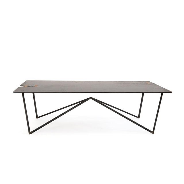 Hewed from 1/4 blackened steel with solid wood details, the Steel Forest Coffee is a statement piece for your space. The...