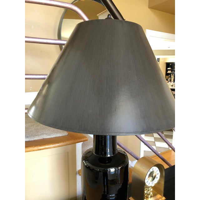 Beautiful stately Asian Style table lamp having a black porcelain vase on brown metal base and custom grey shade. Vase...