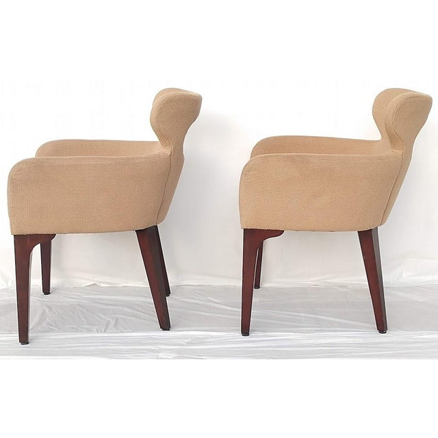A pair of mid-century style lounge chairs by designer Mark David. These are from the Design Masters collection. The chairs...