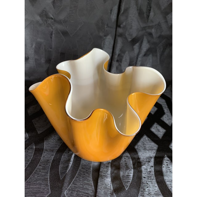 Offered is a Venetian Murano handkerchief vase featuring a white interior layered with glass that resembles the color of...