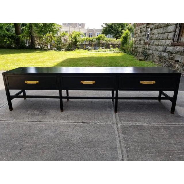 Vintage America of Martinsville very large painted black console table with 3 draws,brass hardware feet and gilt painted...