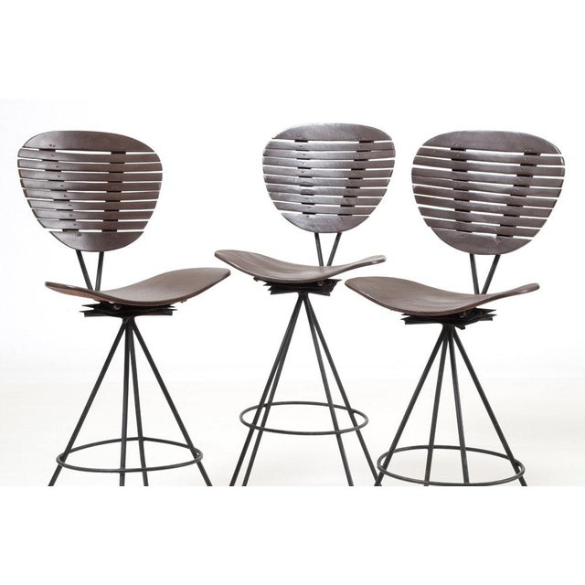 Spice up your patio wet bar with these fun and funky Mid-Century Modern bar stools. The uniquely shaped backs and seats...