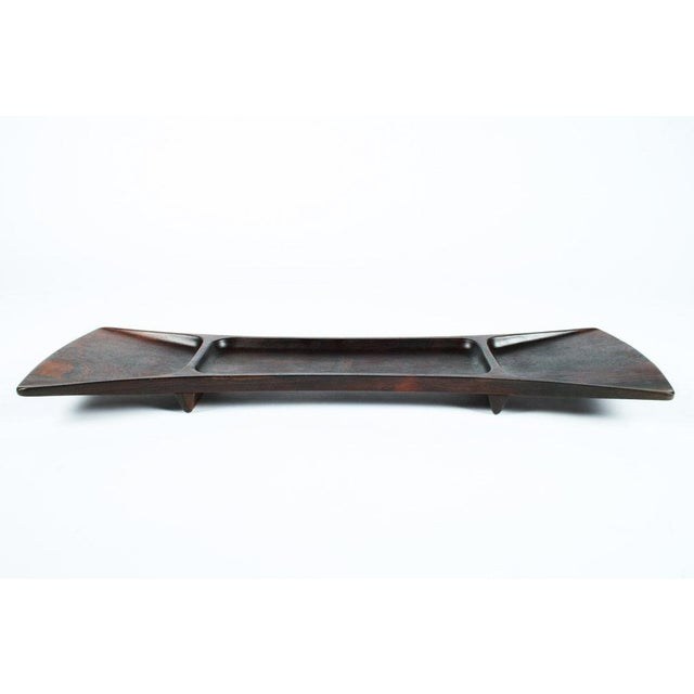 "A gorgeous serving tray made from palisander wood in a ""bowtie"" form with three sections for holding objects, beautiful..."