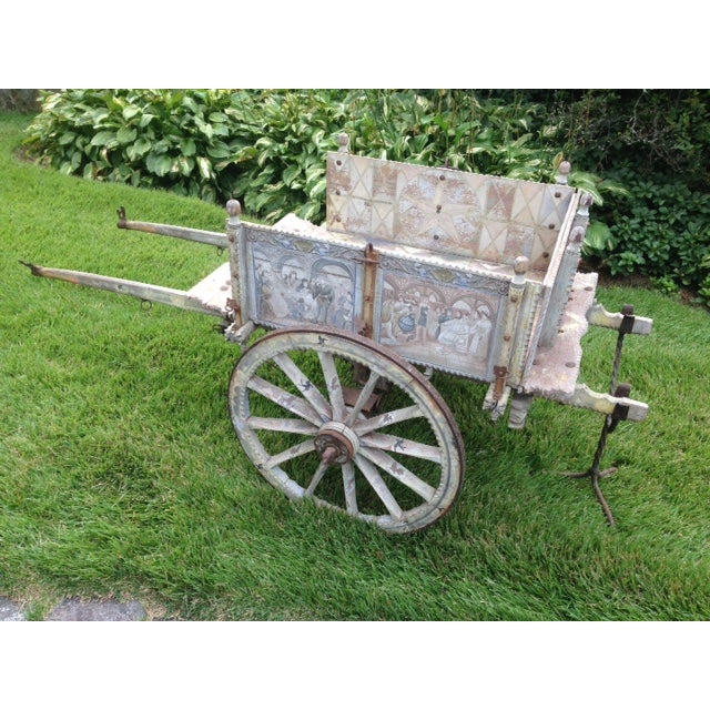 Rare 19th century multi-colored, hand-painted and ornately carved wooden Sicilian Goat Cart. Each side panel depicts...