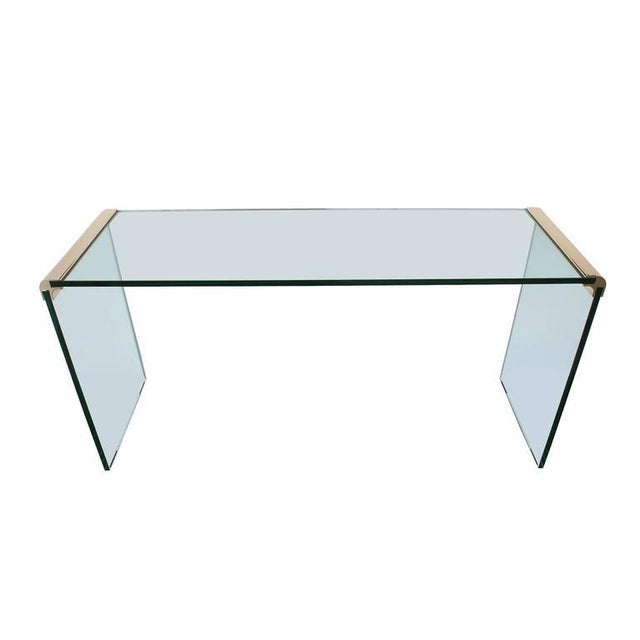 "Elegant waterfall console table designed by Leon Rosen for The Pace Collection. Thick 3/4"" glass connected by corners of..."