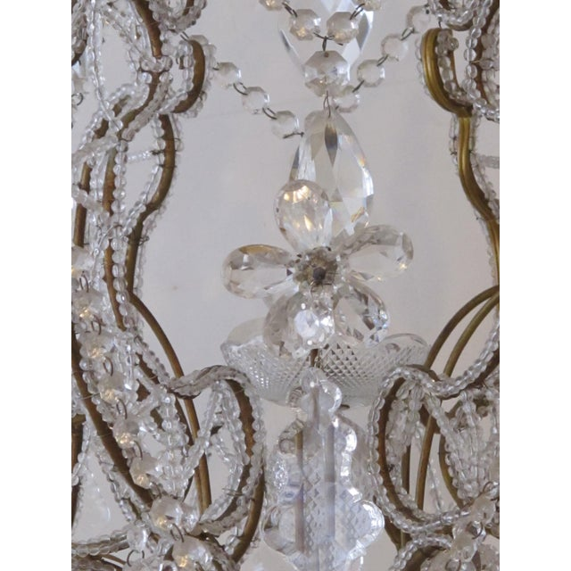 Early 20th Century A lustrous and graceful Italian rococo style cage-form beaded 6-light chandelier with crystal pendants, flowers and swags For Sale - Image 5 of 6