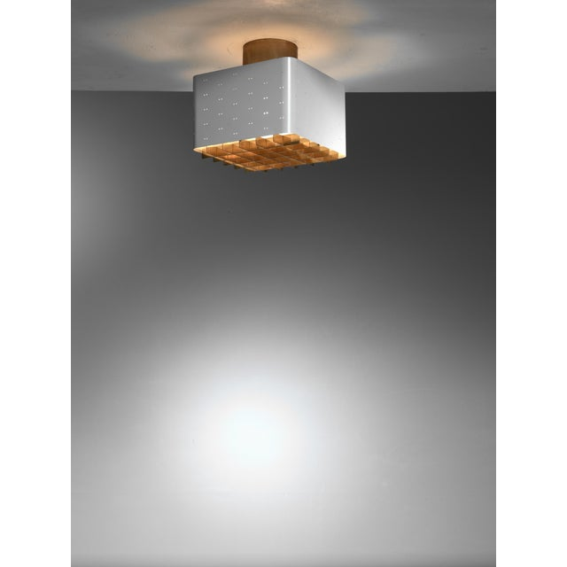 A model 9068 ceiling lamp by Paavo Tynell for Idman. The lamp is made of white lacquered metal and has a brass ceiling...