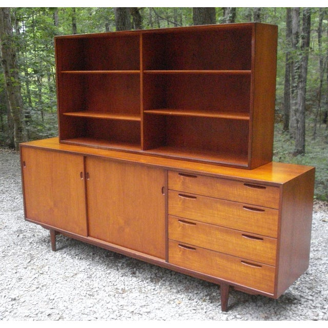 Amazing 1950s Danish Modern matching hutch and credenza designed by Arne Hovmand Olsen for Selig. Extraordinary rosewood...