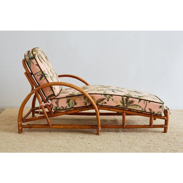 Festive three strand rattan chaise lounge or longue made in the manner and style of Paul Frankl. Authentic steam bent...