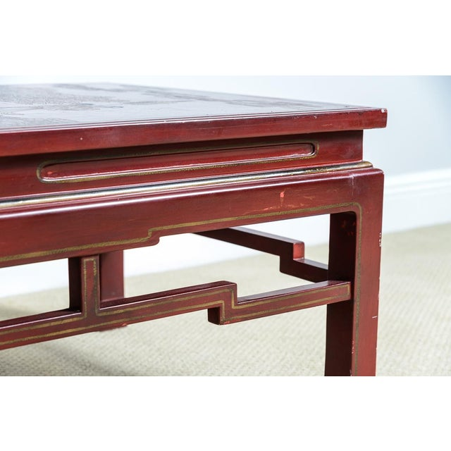 Antique Chinese Red Lacquer rectangular CoffeeTable with an Asian Decorative Panel Top. Beautiful quality decor of...