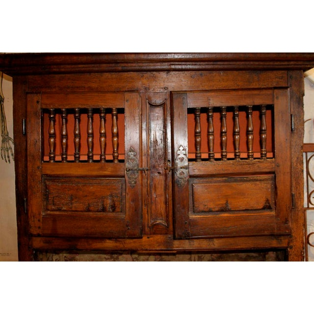 2 piece walnut and french oak cabinet. Spindle and raised panel doors and drawers. Wonderful hand cut moldings. Raised...