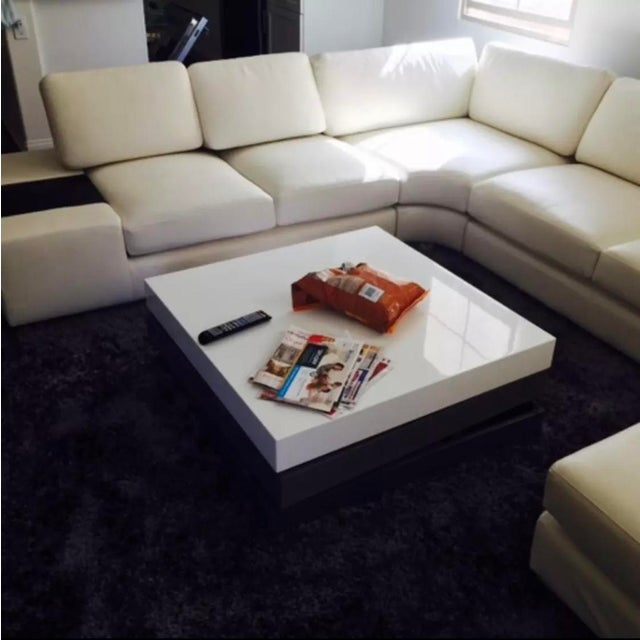 The T35 white leather sectional sofa with two end tables reveals a pioneering design featuring a built-in light on the end...