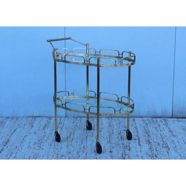 1950s solid brass signed patinated brass bar cart by Maxwell-Phillip.