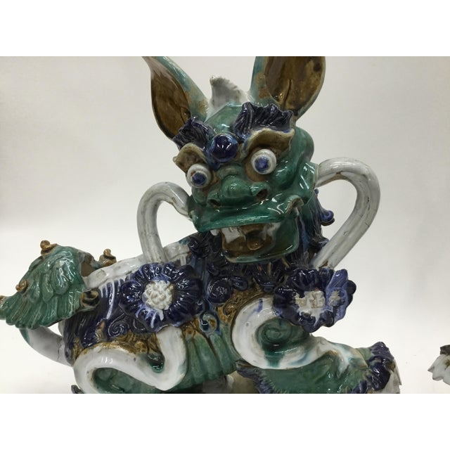 Fabulous pair of glazed ceramic guardian foo dogs for your home or garden. Early 20th century vintage.